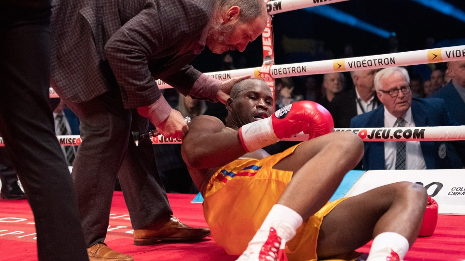 Ring doctor Marc Gagne, left, checks on Adonis Stevenson, of Montreal, after he was knocked out by Oleksandr Gvozdyk of Ukraine in their Light Heavyweight WBC championship fight, Saturday, December 1, 2018 in Quebec City. THE CANADIAN PRESS/Jacques Boissinot