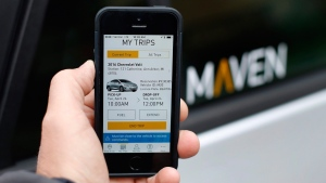 A smartphone displays the Maven app, a General Motors car-sharing service, in Ann Arbor, Mich., on April 27, 2016. THE CANADIAN PRESS/AP, Paul Sancya