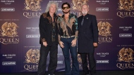 """In this Aug. 28, 2018, file photo, Brian May, from left, Adam Lambert, and Roger Taylor of Queen + Adam Lambert pose for a photo at the """"The Crown Jewels"""" residency press conference at the MGM Resorts aviation hanger in Las Vegas. (Photo by Al Powers/Powers Imagery/Invision/AP, File)"""