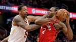 Toronto Raptors' Kawhi Leonard (2) drives past Cleveland Cavaliers' Channing Frye (9) in the second half of an NBA basketball game, Saturday, Dec. 1, 2018, in Cleveland. Frye was called for the foul. The Raptors won 106-95. (AP Photo/Tony Dejak)