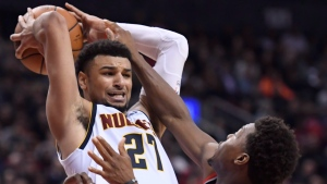 Toronto Raptors guard Kyle Lowry (7) pressures Denver Nuggets guard Jamal Murray (27) during second half NBA basketball action in Toronto on Monday, December 3, 2018. THE CANADIAN PRESS/Nathan Denette