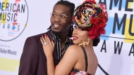 In this Oct. 9, 2018, file photo, Offset, left, and Cardi B arrive at the American Music Awards at the Microsoft Theater in Los Angeles. Cardi B is no longer feeling the love after little more than a year of marriage to fellow rapper Offset. (Photo by Jordan Strauss/Invision/AP, File)