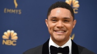 In this Sept. 17, 2018, file photo, Trevor Noah arrives at the 70th Primetime Emmy Awards at the Microsoft Theater in Los Angeles. (Photo by Jordan Strauss/Invision/AP, File)