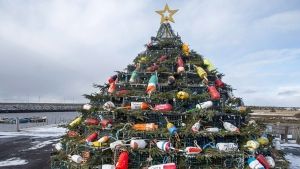 "A Christmas tree made of lobster traps is seen on Cape Sable Island, on Nova Scotia's South Shore, on December 11, 2016. They first started appearing along Canada's east coast about 10 years ago: towering artificial Christmas trees made from carefully stacked lobster traps. Adorned with colourful buoys, twinkling lights and evergreen boughs, they are becoming regular fixtures in fishing communities across Atlantic Canada. ""They are popping up everywhere,"" says Suzy Atwood, tourism development officer for Barrington, N.S., which assembled one of the region's first trap trees in 2009. THE CANADIAN PRESS/Andrew Vaughan"