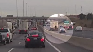 A loose tire bounces in live lanes of traffic on Highway 401 Wednesday December 5, 2018 in this image made from video. (Don Williams /Submitted)