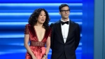 FILE - In this Sept. 17, 2018 file photo, Sandra Oh, left, and Andy Samberg present an award at the 70th Primetime Emmy Awards in Los Angeles. (Photo by Chris Pizzello/Invision/AP, File)