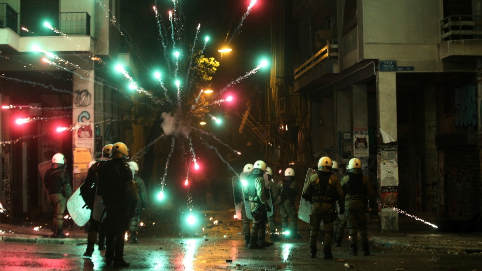 Protesters use fireworks against riot police during clashes in the Athens neighborhood of Exarchia, a haven for extreme leftists and anarchists, Thursday, Dec. 6, 2018. (AP Photo/Yorgos Karahalis)
