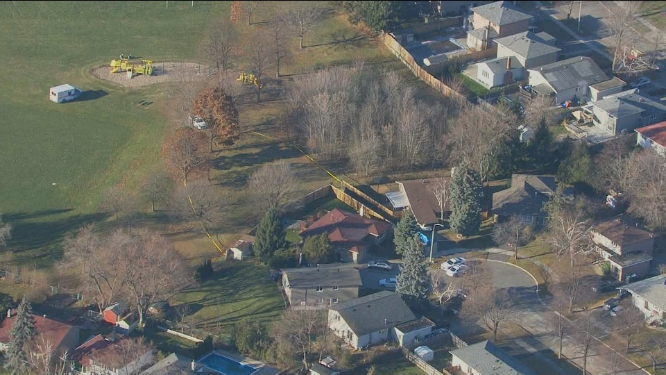 Police vehicles are shown at the scene of a homicide investigation in Mississauga in this aerial photo.