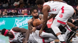 Brooklyn Nets guard D'Angelo Russell, center, vies for the ball against Toronto Raptors forward Pascal Siakam (43) and guard Kyle Lowry (7) during the second half of an NBA basketball game, Friday, Dec. 7, 2018, in New York. (AP Photo/Mary Altaffer)