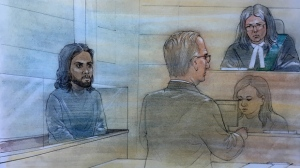 Nicholas Mahabir (left) is shown during his initial court appearance in Brampton on Dec. 8, 2018. (John Mantha)