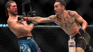 Max Holloway, right, fights Brian Ortega during the UFC Featherweight championship title bout in Toronto on Sunday, Dec. 9, 2018. Holloway won the title fight. THE CANADIAN PRESS/Nathan Denette