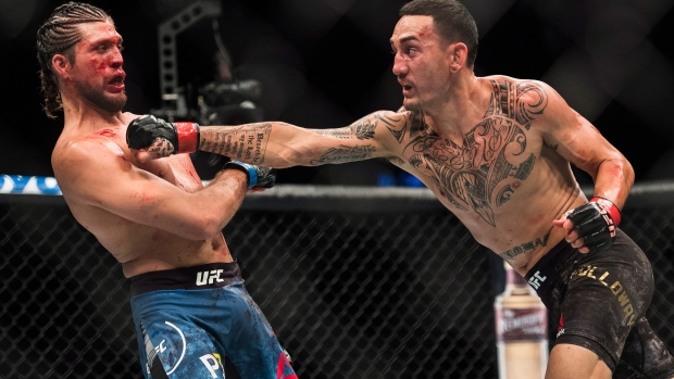 Featherweight Champ Max Holloway Hammers Brian Ortega En Route To Tko At Ufc 231 Cp24 Com