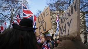 """Demonstrators hold placards at the """"Brexit Betrayal Rally"""", a pro-Brexit rally, on Park Lane in London, Sunday Dec, 9, 2018. MP's are to vote on the EU withdrawal agreement on Tuesday. (AP Photo/Tim Ireland)"""