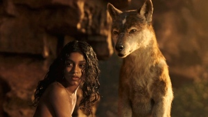 "This image released by Netflix shows Rohan Chand as Mowgli, left, and the character Nishi, voiced by Naomie Harris, in a scene from the film, ""Mowgli: Legend of the Jungle,"" streaming on Netflix on Friday. (Netflix via AP)"