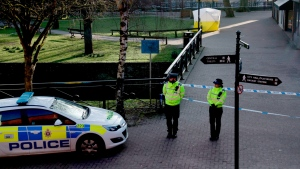 In this Wednesday, March 7, 2018 file photo, police officers guard a cordon around a police tent covering the the spot where former Russian double agent Sergei Skripal and his daughter were found critically ill. (AP Photo/Matt Dunham, File)