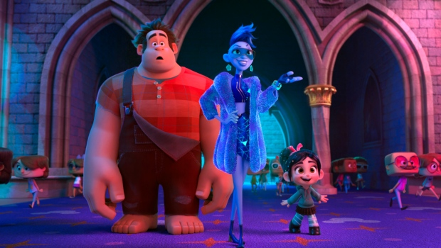 """FILE - This image released by Disney shows characters, from left, Ralph, voiced by John C. Reilly, Yess, voiced by Taraji P. Henson and Vanellope von Schweetz, voiced by Sarah Silverman in a scene from """"Ralph Breaks the Internet."""" (Disney via AP, File)"""