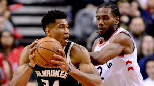 Toronto Raptors forward Kawhi Leonard (2) puts pressure on Milwaukee Bucks forward Giannis Antetokounmpo (34) as he looks for the pass during second half NBA basketball action in Toronto on Sunday, Dec. 9, 2018. THE CANADIAN PRESS/Frank Gunn