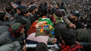 Kashmiri villagers display the body of Saqib Bilal Sheikh during the joint funeral of teenage rebels Saqib Bilal Sheikh and Mudasir Rashid Parray at Hajin village, north of Srinagar, Indian controlled Kashmir, Monday, Dec. 10, 2018. (AP Photo/Mukhtar Khan)