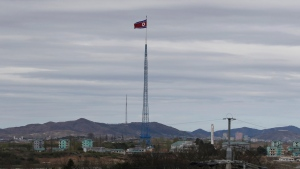 In this April 27, 2018, file photo, a North Korean flag flutters in the wind atop a 160-meter tower in North Korea's village Gijungdongseen, as seen from the Taesungdong freedom village inside the demilitarized zone in Paju, South Korea. (AP Photo/Lee Jin-man, File)