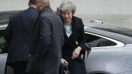 British Prime Minister Theresa May arrives at 10 Downing Street in London, Monday Dec. 10, 2018. MP's are to vote on the EU withdrawal agreement on Tuesday. (AP Photo/Tim Ireland)