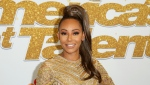 "FILE - In this Sept. 18, 2018 file photo, Mel B arrives at the ""America's Got Talent"" Season 13 Finale Show red carpet in Los Angeles. Brown has suffered an unexplained injury in New York that required surgery to prevent her from losing her hand. B (Photo by Willy Sanjuan/Invision/AP, File)"