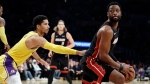 Miami Heat's Dwyane Wade, right, is defended by Los Angeles Lakers' Josh Hart during the second half of an NBA basketball game Monday, Dec. 10, 2018, in Los Angeles. (AP Photo/Marcio Jose Sanchez)