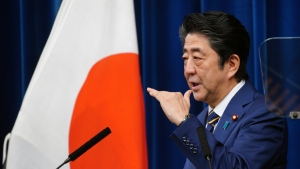 Japanese Prime Minister Shinzo Abe delivers a speech during a press conference at the prime minister's official residence Monday, Dec. 10, 2018, in Tokyo. (AP Photo/Eugene Hoshiko)