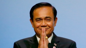FILE - In this Nov. 15, 2018, file photo, Thai Prime Minister Prayuth Chan-ocha gestures the Thai way shortly after accepting the ASEAN Summit and Related Summits' hosting and chairmanship for next year in Thailand from Singaporean Prime Minister Lee Hsien Loong, in Singapore. Prayuth invoked a special executive power Tuesday, Dec. 11, 2018, to ease several restrictions that were set after the army seized power from an elected government. (AP Photo/Bullit Marquez, File)