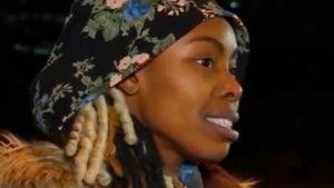 In this image made from video provided by WABC-TV/ABC7, Jazmine Headley speaks to the media after she was released from the Rikers Island jail facility in New York on Tuesday, Dec. 11, 2018. (WABC-TV/ABC7 via AP)