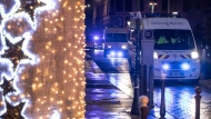 Police vehicles move at the center of the city of Strasbourg following a shooting, eastern France, Tuesday Dec. 11, 2018. A man who had been flagged as a possible extremist sprayed gunfire near the city of Strasbourg's famous Christmas market Tuesday, killing three people, wounding 12 and sparking a massive manhunt. AP Photo/Jean-Francois Badias)