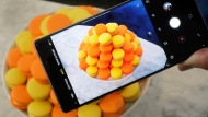 In this Aug. 7, 2018, file photo, the Samsung Galaxy Note 9 is shown in New York. Retailers are taking back some control of the store experience with smartphone app features that let customers do things like scan and pay, as well as download digital maps. (AP Photo/Richard Drew, File)