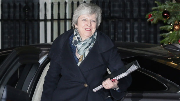 British Prime Minister Theresa May arrives 10 Downing Street for Prime Minister's Questions, in London, Wednesday Dec. 12, 2018. British Prime Minister Theresa May battled on Wednesday to save her job, her EU divorce bill and maybe even Brexit itself as lawmakers in her Conservative Party held a no-confidence vote on her leadership. (AP Photo/Tim Ireland)