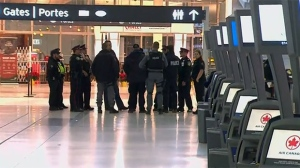 Emergency officials are seen investigating at Toronto Pearson International Airport after a suspicious package was found on Wednesday Dec. 12, 2018.