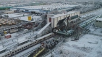 An aerial view of the scene of a train accident in Ankara, Turkey, Thursday, Dec. 13, 2018. A high-speed train hit a railway engine and crashed into a pedestrian overpass at the station in the Turkish capital Thursday, killing several people and injuring scores of others, officials and news reports said. (DHA via AP)
