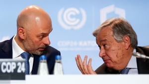 U.N. Secretary-General Antonio Guterres, right, talks to U.N. climate conference president, Poland's Deputy Environment Minister Michal Kurtyka, left, after flying back to the event to urge more effort from the negotiators as they seek ways of fighting climate change, in Katowice, Poland, Wednesday, Dec. 12, 2018.(AP Photo)