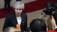 British Prime Minister Theresa May speaks with the media as she arrives for an EU summit at the Europa building in Brussels, Thursday, Dec. 13, 2018. EU leaders gather for a two-day summit, beginning Thursday, which will center on the Brexit negotiations. (AP Photo/Francisco Seco)