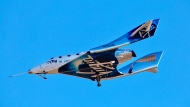 Virgin Galactic reaches space for the first time during its 4th powered flight from Mojave, Calif. The aircraft called VSS Unity reached an altitude of 271,268 feet reaching the lower altitudes of space. (AP Photo/Matt Hartman)