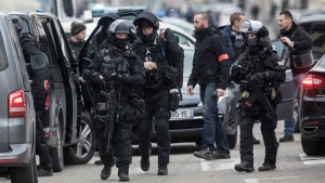 French police forces take position in the Neudorf district of Strasbourg, eastern France, Thursday, Dec. 13, 2018. (AP Photo/Jean-Francois Badias)