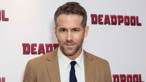 In a Oct. 28, 2016 file photo, actor Ryan Reynolds poses for photographers upon arrival at a fan screening of the film 'Deadpool', in central London. Reynolds will be watching Sunday's Super Bow, he's just not sure which team he wants to win. The Canadian actor said he's a fan of both the Carolina Panthers and Denver Broncos.(Photo by Grant Pollard/Invision/AP, File)