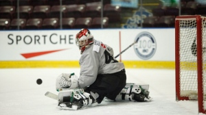 Team Canada goaltender Ian Scott keeps his eye on the puck during selection camp at the Q Centre in Victoria, B.C., on Tuesday, December 11, 2018. THE CANADIAN PRESS/Chad Hipolito