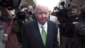 Sen. Mike Duffy leaves the courthouse after being acquitted on all charges Thursday, April 21, 2016 in Ottawa. (THE CANADIAN PRESS/Adrian Wyld)