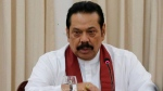 In this Nov. 3, 2018 file photo, Sri Lanka's then appointed prime minister Mahinda Rajapaksa speaks to members loyal to him at his office in Colombo, Sri Lanka. A Sri Lankan court has stayed disputed Prime Minister Rajapaksa and his ministers from holding their positions as it hears an appeal against them. (AP Photo/Eranga Jayawardena)