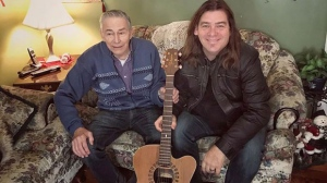 Edward Sheppard and Alan Doyle of the band Great Big Sea pose with Sheppard's new guitar, which Doyle replaced after Sheppard's guitar went missing. THE CANADIAN PRESS/Handout -Aaron Small