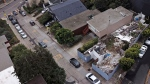 This Friday, Dec. 14, 2018, photo shows the demolished house, right, on a property in San Francisco. (Santiago Mejia/San Francisco Chronicle via AP)