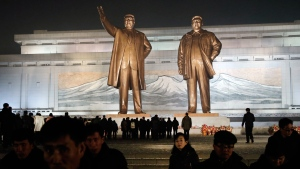 North Korean leave after paying respect to the bronze statues of their late leaders Kim Il Sung and Kim Jong Il at Mansu Hill Grand Monument in Pyongyang, North Korea, Sunday, Dec. 16, 2018. (AP Photo/Dita Alangkara)