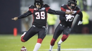 Ottawa Redblacks kicker Zach Medeiros (39) kicks-off against the Calgary Stampeders during first quarter CFL Grey Cup action Sunday, November 27, 2016 in Toronto. THE CANADIAN PRESS/Frank Gunn