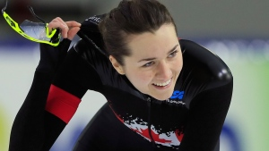 Canada's Isabelle Weidemann celebrates after competing in the women's 3,000 meters race of the World Cup speed skating at the Thialf ice arena in Heerenveen, Netherlands, Sunday, Dec.16, 2018. (AP Photo/Peter Dejong)