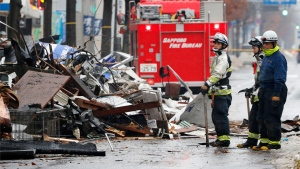 Firefighters work at the scene of an explosion in Sapporo, Japan, Monday, Dec. 17, 2018.  (Masanori Takei/Kyodo News via AP)