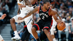Toronto Raptors forward Kawhi Leonard, right, picks up a loose ball as Denver Nuggets forward Torrey Craig defends in the second half of an NBA basketball game, Sunday, Dec. 16, 2018, in Denver. The Nuggets won 95-86. (AP Photo/David Zalubowski)