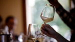 In this image taken on Monday, Oct. 15, 2018, an expert wine tester shakes a glass of Prosecco during a wine testing at the Case Paolin farm, in Volpago del Montello, Italy. Prosecco has become the best-selling sparkling wine in the world, and experts say it is eroding the more casual corner of champagne's market while aiming higher. Its production eclipsed champagne's five years ago and is now 75 percent higher at 544,000 bottles three-quarters of which for export.0 bottles three-quarters of which for export.(AP Photo/Luca Bruno)